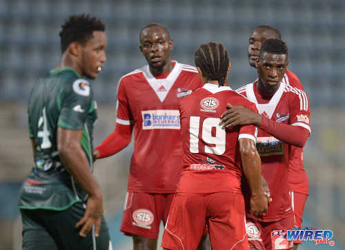 Photo: Central FC defender Andre Ettienne (second from left) looks on as teammate Nathaniel Garcia (centre) replaces Elton John in last night's Digicel Charity Shield. (Courtesy DPI Photography/Wired868)