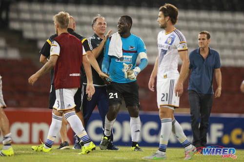 Photo: LA Galaxy coach Bruce Arena (centre) congratulates Central FC custodian Jan-Michael Williams, after their 1-1 tie in CONCACAF Champions League action in August 2015. (Courtesy Allan V Crane/Wired868)