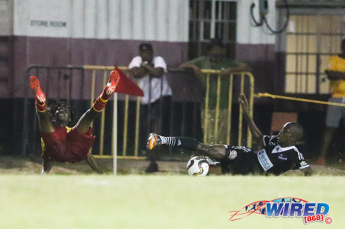 Photo: Central FC attacker and former Point Fortin Civic star Marcus Joseph (right) floors former teammate Akeem Redhead with a tackle at Mahaica Oval yesterday. (Courtesy Chevaughn Christopher/Wired868)