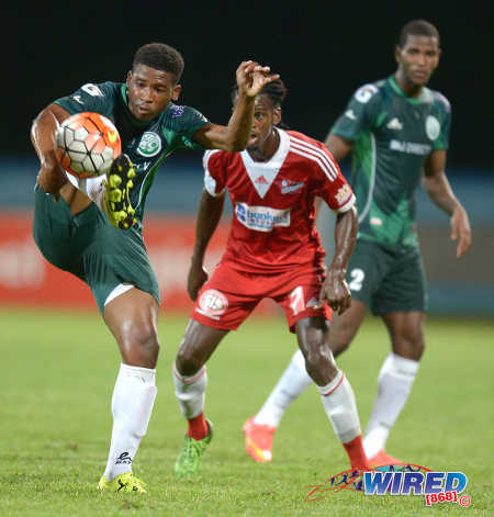 Photo: W Connection substitute Aikim Andrews (left) tries to control the ball as teammate Kurt Frederick (right) and Central FC's Jason Marcano look on during last night's Digicel Charity Shield match. (Courtesy DPI Photography/Wired868)