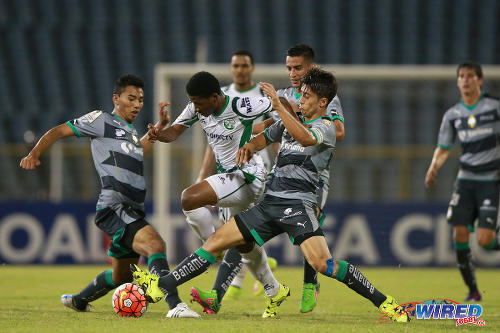 Photo: W Connection's Aikim Andrews (centre) tries to find way past a gang of Santos Laguna players during CONCACAF Champions League action at the Hasely Crawford Stadium in Port of Spain. (Courtesy Allan V Crane/Wired868)