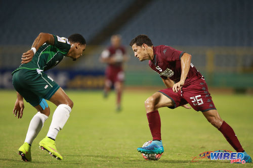 Photo: Deportivo Saprissa winger Daniel Colindres (right) tries to find a way past W Connection captain and defender Alvin Jones in CONCACAF Champions League action yesterday. (Courtesy Allan V Crane/Wired868)