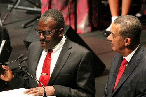 Photo: President Anthony Carmona (right) swears in National Security Minister Edmund Dillon.