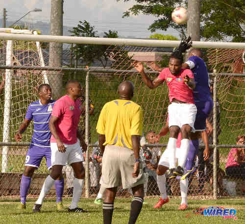 Photo: Guaya United defender Leroy Jones (second from right) challenges Defence Force captain Chris Durity for an aerial ball during NSL Super League action yesterday. (Courtesy DPI Photography/Wired868)