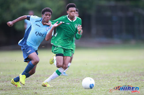 Photo: QRC midfielder Joash Williams (left) tries to outrun St Augustine Secondary midfielder Jesse Joseph during 2015 SSFL action. (Courtesy Allan V Crane/Wired868)