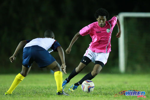 Photo: Malabar FC midfielder Dominic Douglas (right) takes on an Edinburgh 500 player during a previous CNG National Super League Championship Division contest at Dabadie Recreation Grounds.  (Courtesy Allan V Crane/Wired868)