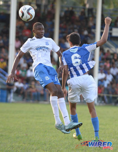 Photo: Naparima College midfielder Seon Shippley (left) wins an aerial challenge against St Mary's College defender Samuel Affonso in SSFL action yesterday. (Courtesy DPI Photography/Wired868)