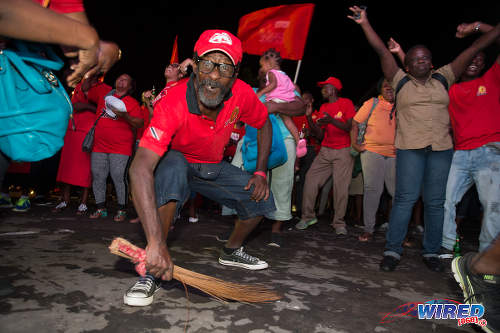 Photo: Whaddap, cocoyea! A PNM supporter celebrates at Balisier House after the election results on 7 September 2015. (Courtesy Allan V Crane/Wired868)