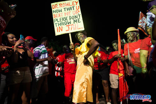 Photo: PNM supporters poke fun at the outgoing Prime Minister on 7 September 2015 at Balisier House. (Courtesy Allan V Crane/Wired868)