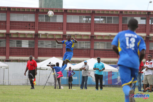 Photo: Shiva Boys HC winger Rodney Quinn wins a header yesterday against Fatima College. (Courtesy Sinead Peters/Wired868)