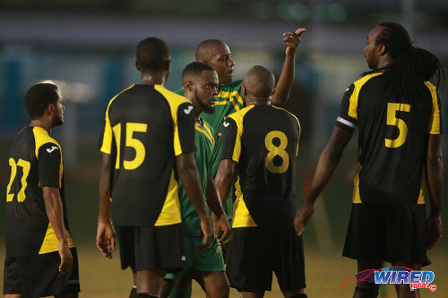 Photo: Things get a little heated as a Stokely Vale player (centre) tries to make a point against WASA FC in CNG National Super League action. (Courtesy Allan V Crane/Wired868)
