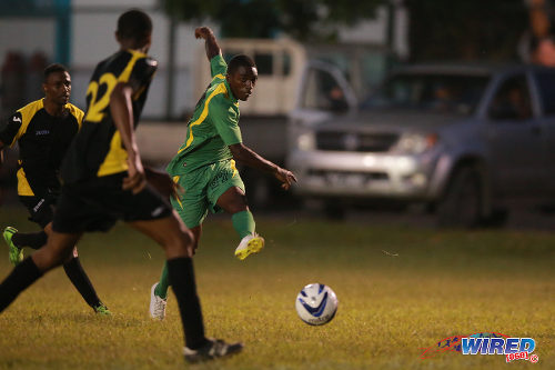 Photo: A Stokely Vale attacker (right) shoots for goal in CNG National Super League action against WASA FC. (Courtesy Allan V Crane/Wired868)