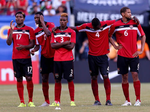 Photo: Trinidad and Tobago players (from left) Mekeil Williams, Ataulla Guerra, Joevin Jones, Sheldon Bateau and Radanfah Abu Bakr look on during their penalty shoot out with Panama at the 2015 CONCACAF Gold Cup. (Copyright AFP 2015)