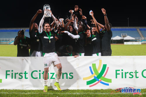 Photo: W Connection captain Alvin Jones lifts the 2015 First Citizens Cup trophy with his teammates, after they edged Central FC 2-1 at the Ato Boldon Stadium, Couva.  (Courtesy Allan V Crane/Wired868)