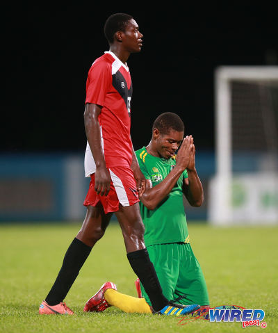 Photo: Guaya United Carlon Hughes (right) thanks the heavens after his crucial goal in his team's 2015 CNG National Super League Knock Out semifinal win over Tobago FC Phoenix 1976 at the Ato Boldon Stadium in Couva. (Courtesy Kerlon Orr/Wired868)