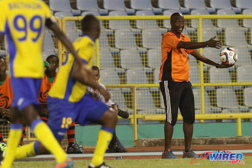 Photo: San Juan Jabloteh coach Keith Jeffrey (right) offers encouragement to his troops during their 2015 First Citizens Cup clash with Defence Force. (Courtesy Chevaughn Christopher/Wired868)