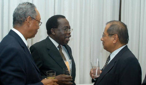 Photo: Former Petrotrin executive chairman Malcolm Jones (centre). (Courtesy Firstmagazine.com)