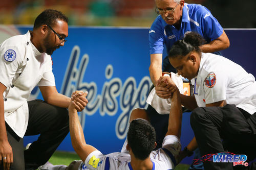 Photo: Stretcher bearers attend to a Nicaragua player during friendly international action against Trinidad and Tobago yesterday in Port of Spain. (Courtesy Allan V Crane/Wired868)