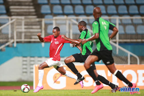 Photo: Action between Petrotrin Palo Seco and Trinidad and Tobago Prisons Service FC in the CNG National Super League knock out At the Ato Boldon Stadium,Couva on Sunday.  (Courtesy: Wired868)