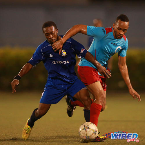 Photo: FC Santa Rosa midfielder Durwin Ross and Marabella Family Crisis Centre winger Dwayne Edwards fight for possession during 2015 CNG NSL action in Macoya. (Courtesy Allan V Crane/Wired868)