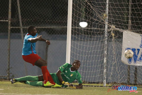 Photo: FC Santa Rosa goalkeeper Kitwana Manning (right) looks on as the ball bounces wide, after a reflex stop from Marabella Family Crisis Centre captain Ghymo Harper during 2015/16 NSL Premiership Division. (Courtesy Allan V Crane/Wired868)