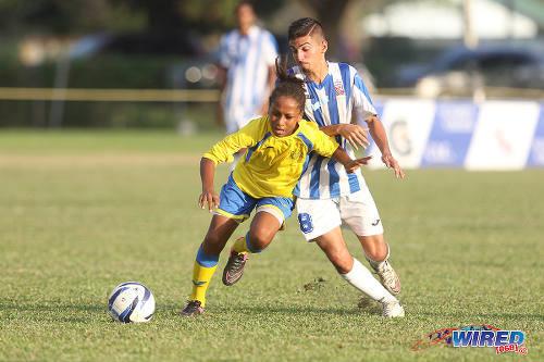 Photo: Shiva Boys HC substitute Judah Garcia (left) beats St Mary's College midfielder Daniel Conocchiari to the ball during SSFL action at Serpentine Road. (Courtesy Chevaughn Christopher/Wired868)