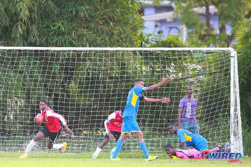 Photo: St Anthony's College celebrate a late equaliser while Shiva Boys HC goalkeeper Denzil Smith (right) and his teammates appeal to the match officials. (Courtesy Kerlon orr/Wired868)