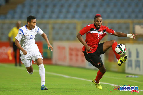 Photo: Trinidad and Tobago winger Joevin Jones (right) takes on Nicaragua right back Joseue Quijano during friendly action at the Hasely Crawford Stadium on 13 October 2015. (Courtesy Allan V Crane/Wired868)