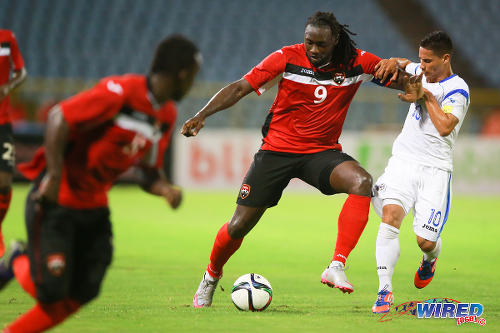 Photo: Trinidad and Tobago captain Kenwyne Jones (centre) holds off Nicaragua midfielder Elvis Figueroa during international friendly action at the Hasely Crawford Stadium on 13 October 2015. (Courtesy Allan V Crane/Wired868)