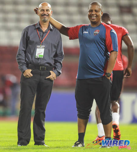 Photo: Trinidad and Tobago National Senior Team coach Stephen Hart (left) enjoys a light moment with assistant coach Derek King before kick off against Nicaragua on13 October 2015 in Port of Spain. (Courtesy Allan V Crane/Wired868)