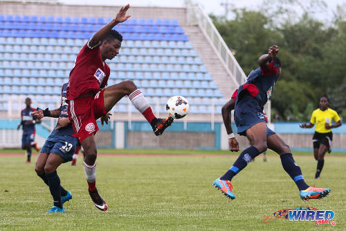 Photo: Central FC striker Willis Plaza (centre) controls the ball during Toyota Classic quarterfinal action this evening against Morvant/Caledonia United. (Courtesy Chevaughn Christopher/Wired868)