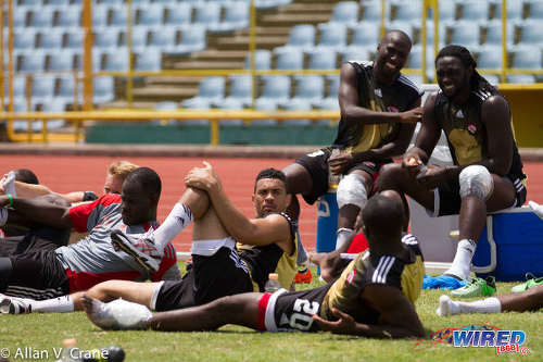 Photo: Trinidad and Tobago forwards Cornell Glen (top left) and Kenwyne Jones (top right) have a laugh during treatment at a pre-2013 CONCACAF Gold Cup training session. (Courtesy Allan V Crane/Wired868)