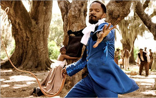 "Photo: Django (right) rescues a slave and administers a flogging of his own in the movie ""Django Unchained."""