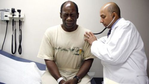 Photo: A doctor tends to his patient. (Copyright BET)