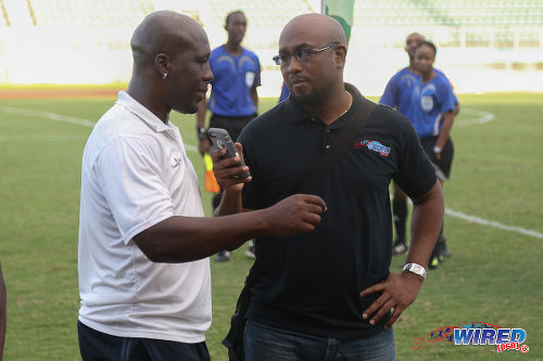 Photo: Guaya United co-coach Akeno Morgan (left) discusses the CNG NSL KO final with Wired868 director Lasana Liburd. (Courtesy Chevaughn Christopher/Wired868)