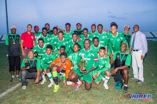Photo: SSFL president Anthony Creed (right) poses with 2015 East Zone Intercol champions, St Augustine Secondary. (Courtesy Amigo Garraway/Wired868)