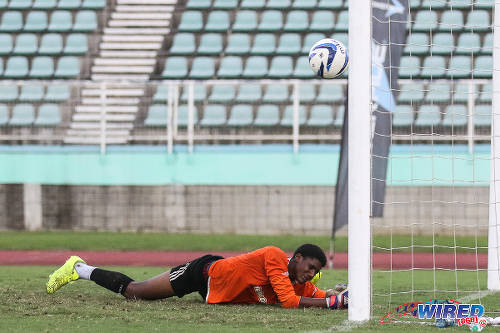 Photo: St Augustine Secondary goalkeeper Yannic Gamaldo struggles to hold back the tears after failing to keep out Shobal Celestin's stoppage time winner for Naparima College in the 2015 Intercol semifinals. (Courtesy Chevaughn Christopher/Wired868)