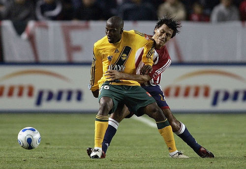 Photo: LA Galaxy striker Cornell Glen (foreground) keeps the ball away from a Chivas USA defender during MLS action in 2006. (Copyright AFP 2015)