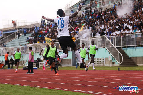 Photo: Naparima College forward Isaiah Hudson leaps into the air to celebrate his goal against Presentation College (San Fernando) in the 2015 South Zone Intercol final at the Mannie Ramjohn Stadium, Marabella. (Courtesy Chevaughn Christopher/Wired868)