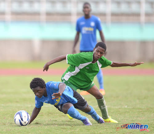 Photo: Naparima College full back Nicholas Thomas (left) in action against Princes Town West in 2015 South Zone Intercol action. Naparima won 4-0. (Courtesy DPI Photography/Wired868)