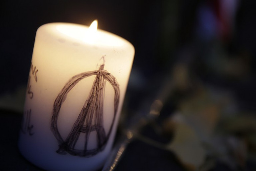 Photo: Paris is in mourning after terrorist attacks on Friday November 13. (Copyright AFP 2015/Kenzo Tribouilard)
