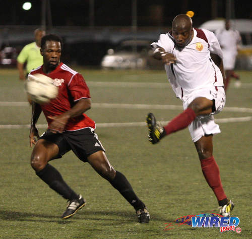 Photo: Cornell Glen (right) thumps home a volley for North East Stars during Pro League action against Central FC in the 2012/13 season. (Courtesy Wired868)