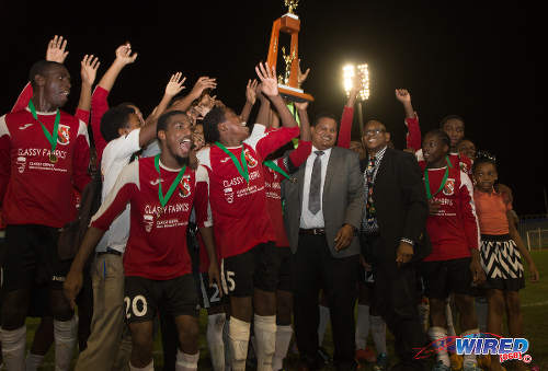 Photo: Sport Minister and ex-St Mary's College football captain Darryl Smith (centre) and SSFL president Anthony Creed (fourth from right) congratulate 2015 North Zone Intercol champs, St Anthony's College. (Courtesy Nicholas Bhajan/Wired868)