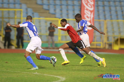 Photo: St Anthony's College winger Kathon St Hillaire charges at the St Mary's College defence on the way to scoring his team's third goal in the 2015 North Zone Intercol final at the Hasely Crawford Stadium. (Courtesy Nicholas Bhajan/Wired868)