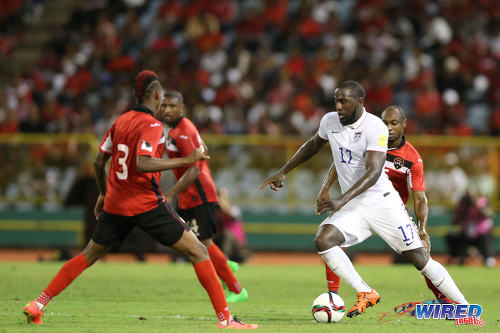 Photo: United States forward Jozy Altidore (right) runs at the Trinidad and Tobago defence during 2018 World Cup qualifying action at the Hasely Crawford Stadium. (Courtesy Allan V Crane/Wired868)