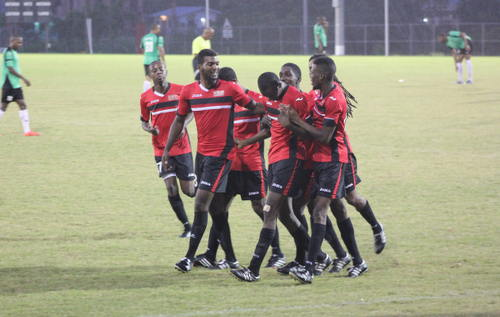 Photo: UTT defender Kevon Noriega (second from left) and his squad celebrate during 2015 NSL action against Prisons FC. (Copyright Anita Sidial)