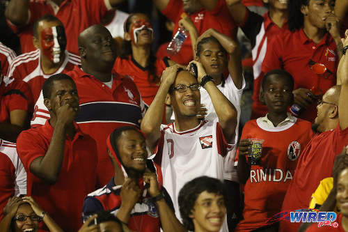 Photo: Trinidad and Tobago football fans react to action during their team's goalless draw with the United States yesterday in 2018 World Cup qualifying action at the Hasely Crawford Stadium in Port of Spain. (Courtesy Chevaughn Christopher/Wired868)