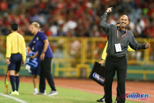 Photo: Trinidad and Tobago coach Stephen Hart (right) urges his team forward during 2018 World Cup qualifying action against the United States at the Hasely Crawford Stadium on 17 November 2015. (Courtesy Allan V Crane/Wired868)
