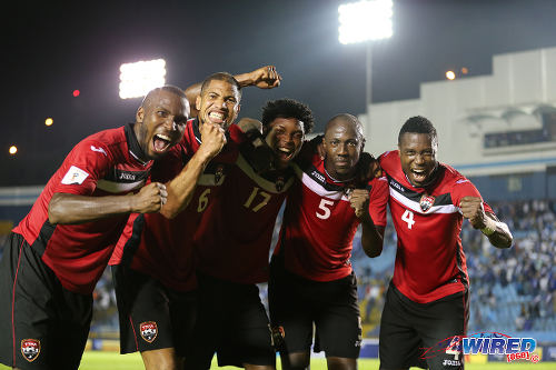 Photo: Trinidad and Tobago players (from left) Khaleem Hyland, Radanfah Abu Bakr, Mekeil Williams, Daneil Cyrus and Sheldon Bateau celebrate their 2-1 World Cup qualifying win over Guatemala on 13 November 2015. (Courtesy Allan V Crane/Wired868)