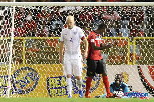 Photo: Trinidad and Tobago goalkeeper Jan-Michael Williams (right) enjoys a calm moment with teammate Sheldon Bateau (centre) and United States midfielder Michael Bradley in attendance during 2018 World Cup qualifying action at the Hasely Crawford Stadium. (Courtesy Allan V Crane/Wired868)